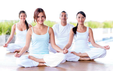 yoga: Group of people meditating in a yoga studio