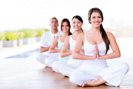 Group of people doing yoga exercises and smiling photo