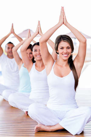 yoga class: Group of people meditating in a yoga class Stock Photo