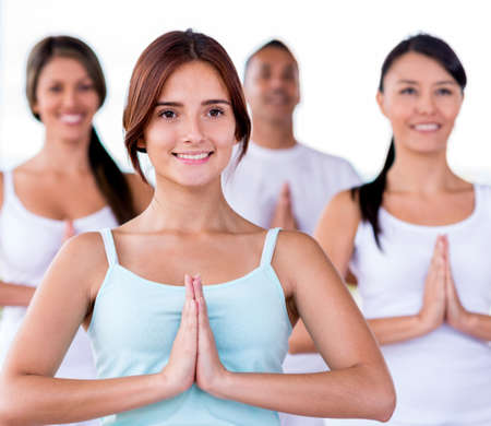 Group of people in a yoga class photo