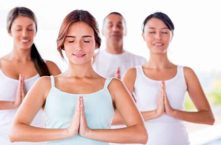 adult class: Group of people meditating in a yoga class Stock Photo