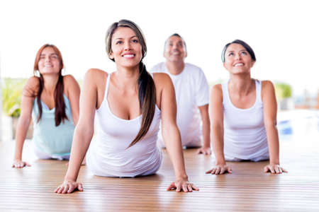 Group of people in a yoga class looking very happy photo