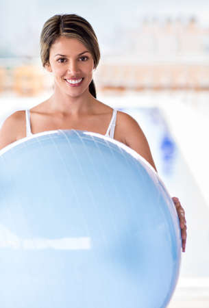swiss ball: Fit woman exercising with a Pilates ball