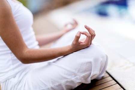 woman meditation: Yoga woman meditating and making a zen symbol with her hand