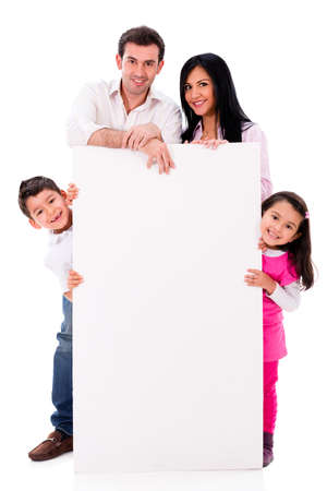 family relationships: Happy family with a banner - isolated over a white background Stock Photo