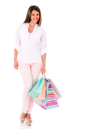 Happy female shopper holding hsopping bags - isolated over a white background Stock Photo - 20198846