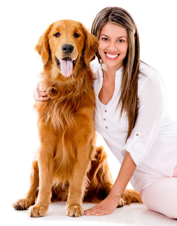 Happy woman with a beautiful dog - isolated over white background photo