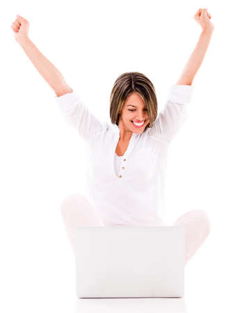 successful woman: Successful woman with a laptop - isolated over a white background