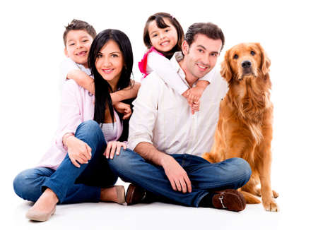 happy: Happy family with a dog - isolated over a white background Stock Photo