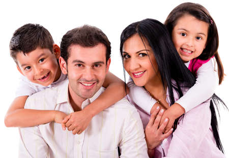 latin family: Beautiful family portrait smiling - isolated over a white background