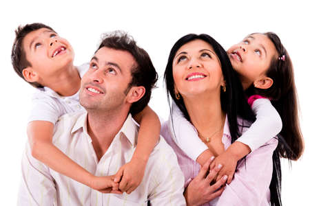 latin family: Happy family portrait looking up - isolated over white Stock Photo