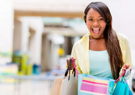 american content: Excited shopping woman looking at her purchases