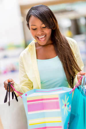 Surprised shopping woman looking into a bag Stock Photo - 20471461