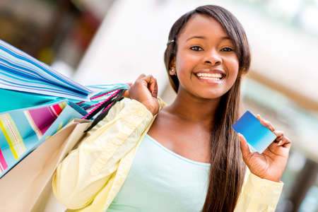american content: Female shopper with a credit card looking very happy Stock Photo