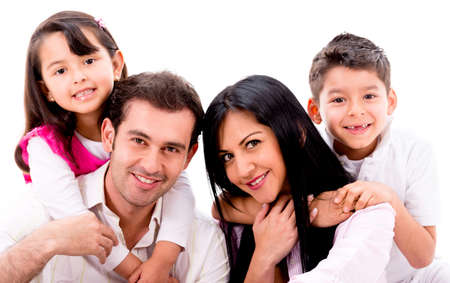 latin family: Happy family portrait - isolated over a white background