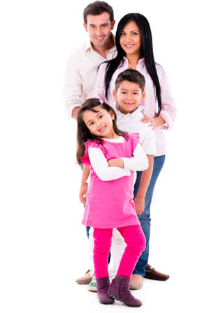 latin family: Beautiful family smiling - isolated over a white background