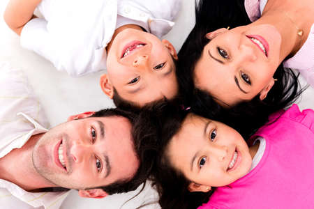 latin girls: Family portrait with heads together lying on the floor