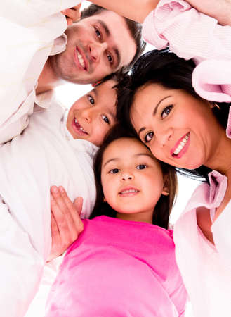 Loving family hug - isolated over a white background photo