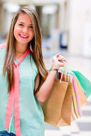 Beautiful shopping woman smiling and holding bags Stock Photo - 20471134