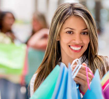 Portrait of a happy shopping girl at the mall Stock Photo - 20230020