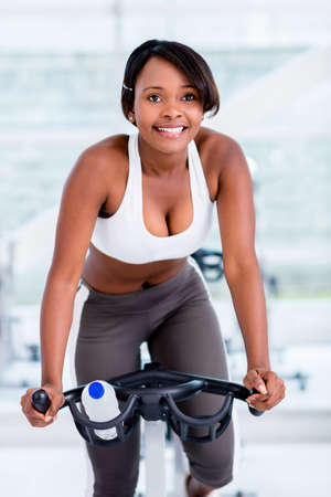 Woman working out at the gym doing spinning photo