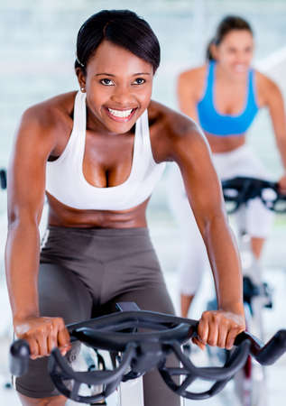 Fit people doing spinning at the gym - healthy lifestyle concepts photo