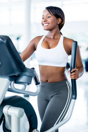 cardio fitness: Fit woman exercising at the gym on an xtrainer