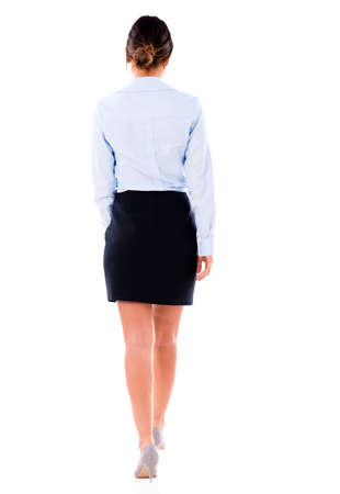 business woman legs: Business woman walking away - isolated over a white background Stock Photo