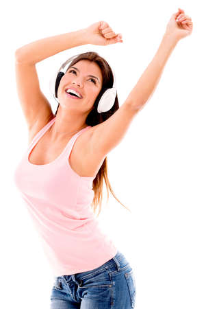 Happy woman listening to music with headphones – isolated over white photo