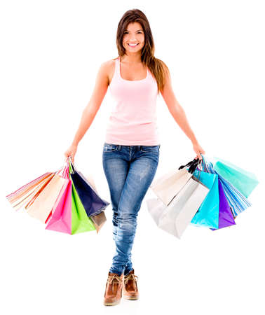 Happy shopping woman with bags- isolated over a white background Stock Photo - 20472790