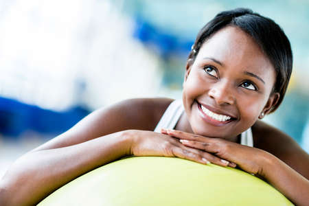 pilates: Beautiful woman at the gym with a Pilates ball Stock Photo