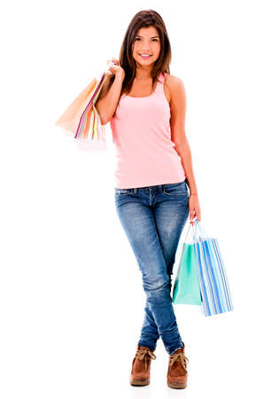 Happy female shopper holding shopping bags - isolated over white   Stock Photo - 20617957