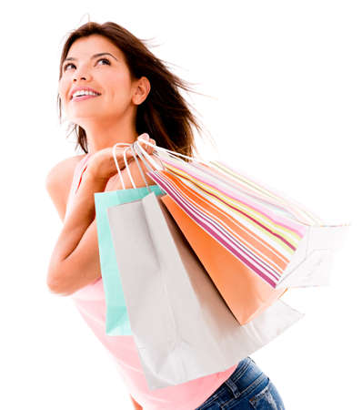 Happy shopping woman holding bags - isolated over a white background  photo