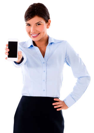 Business woman showing mobile phone - isolated over white  photo