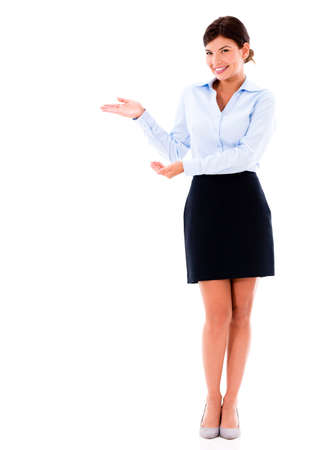 exhibiting: Welcoming business woman presenting something - isolated over white