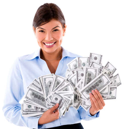 millionaire: Millionaire business woman holding dollar bills - isolated over white