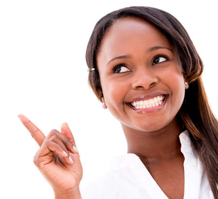 Happy black woman pointing an idea - isolated over a white background  photo