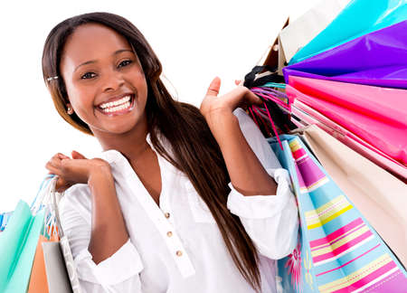 Beautiful shopping woman looking very happy - isolated over white  photo