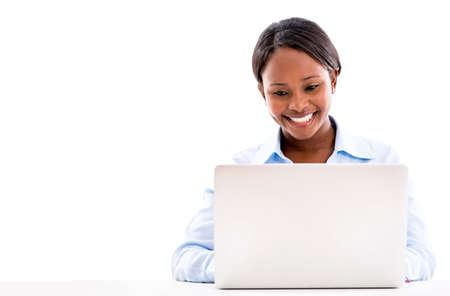 Business woman working online on a laptop computer - isolated  photo