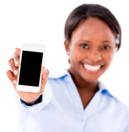 Business woman showing cell phone - isolated over white photo