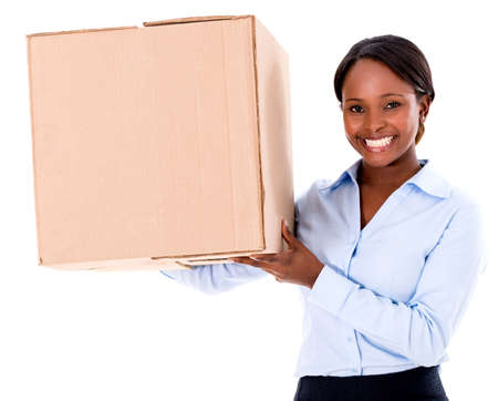 delivery package: Business woman moving and holding a box - isolated over white