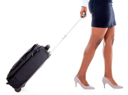 carying: Woman on a business trip carying a bag - isolated over white