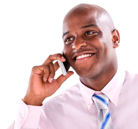 Business man talking on the phone - isolated over white background  photo