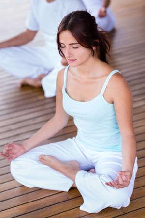 meditation symbol: Beautiful yoga woman meditating with eyes closed