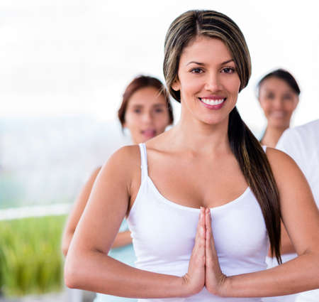 Female yoga instuctor looking very happy in a class  Stock Photo - 20615730