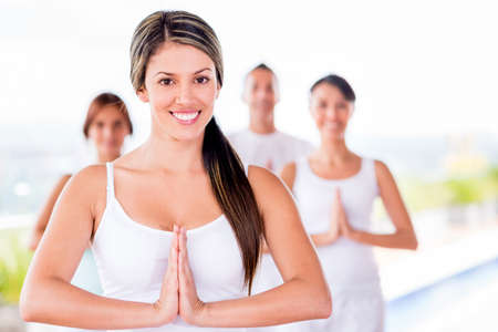 Woman in a yoga class with a group of people  Stock Photo - 20615767