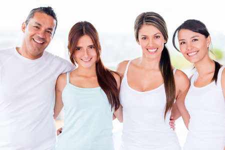 Group of people in a yoga class looking happy Stock Photo - 20615821