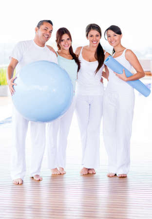 Group of people in a Pilates class looking happy  photo