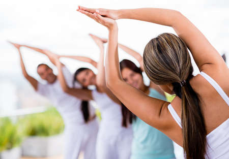 adult class: Group of people doing yoga and stretching  Stock Photo