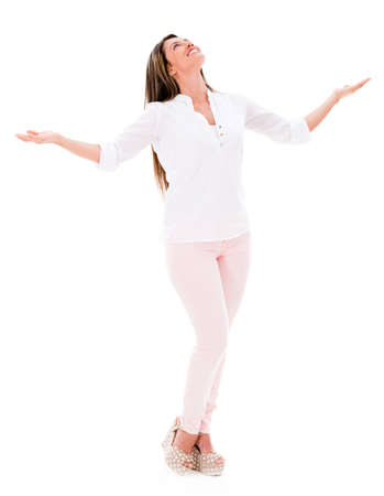 Happy woman with arms open and smiling - isolated over white  Stock Photo - 20622086